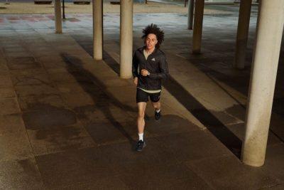 man running in dark garage