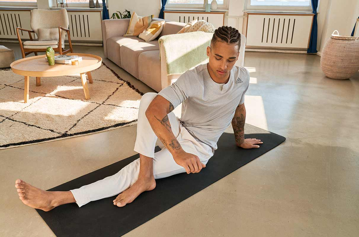 man stretching to recover