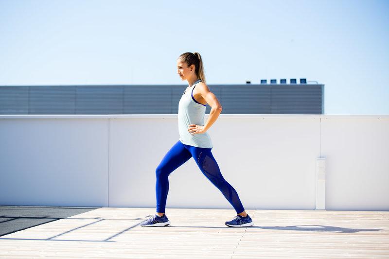 Woman doing a half stretch