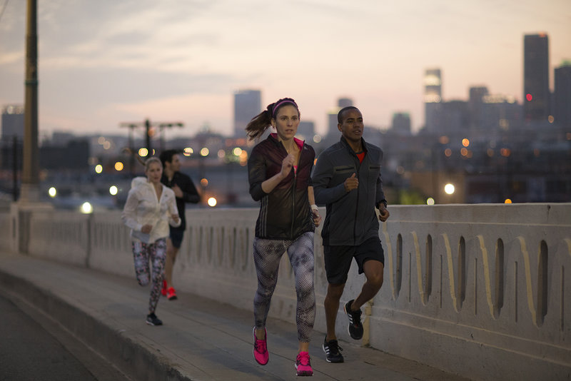 Group of young people running at dawn