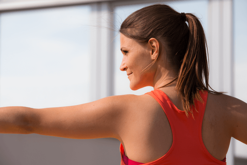 Woman is doing yoga outside