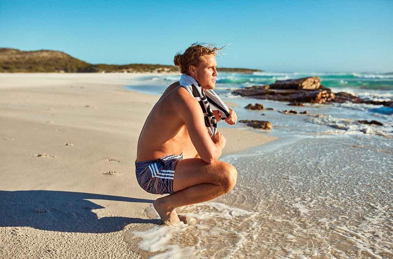man recovering at beach
