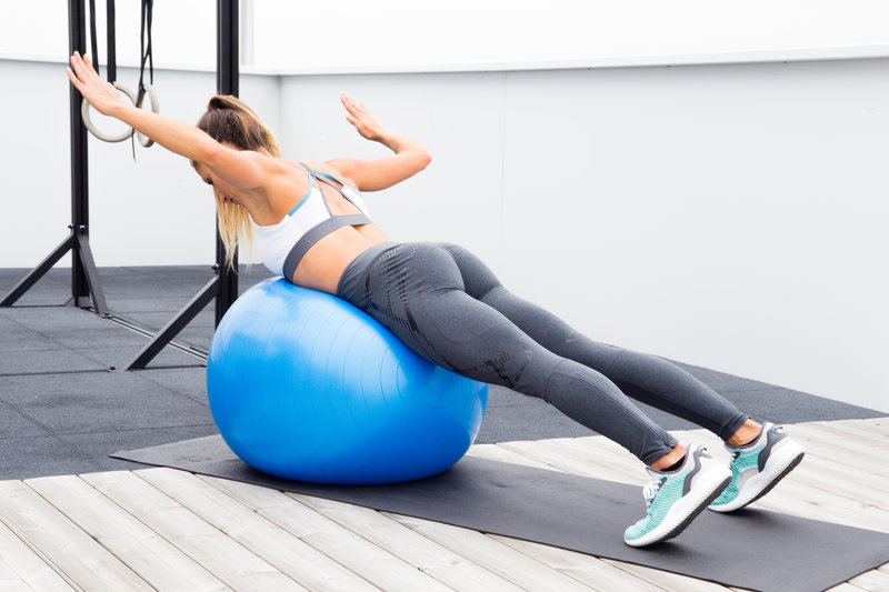 Prone ball wide row with rotation