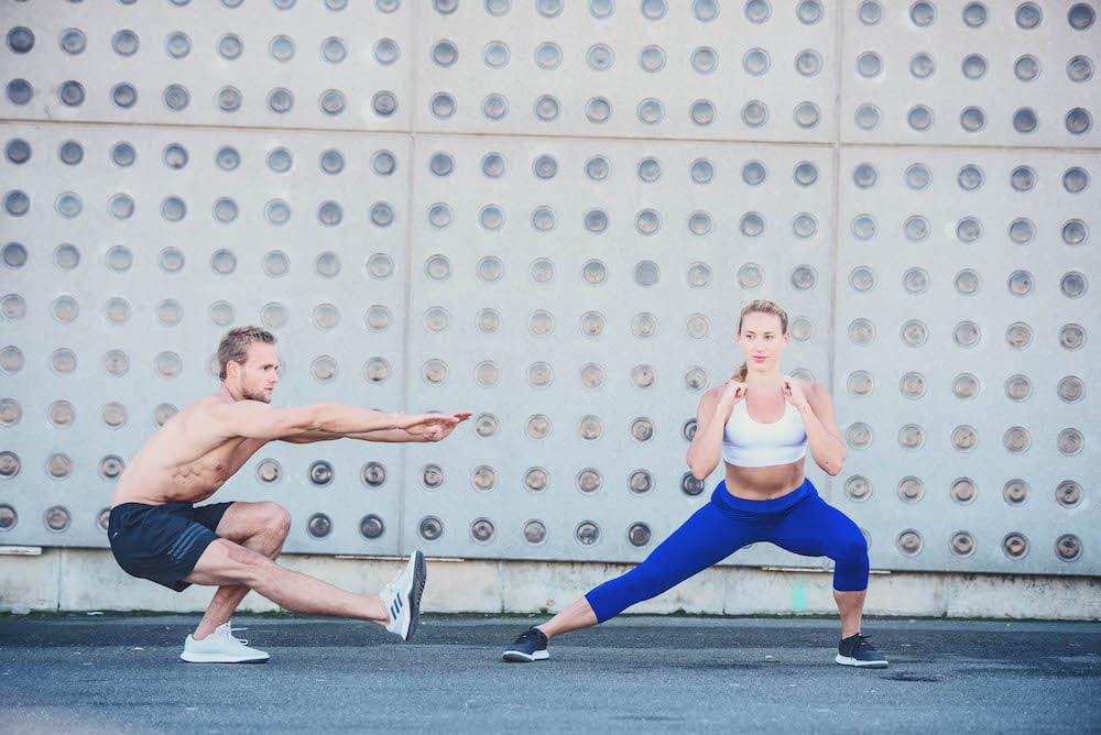 Man and woman doing leg exercises