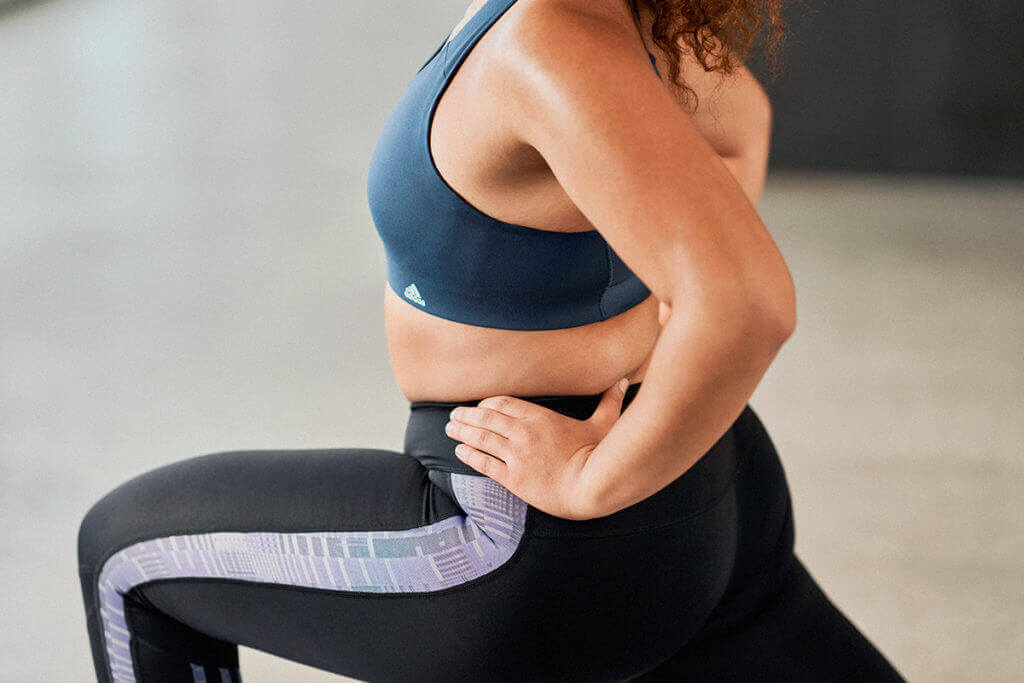 Close up of a woman doing a stretching exercise