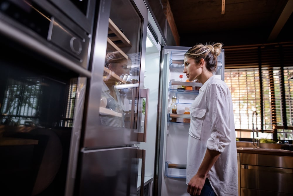 woman opening the fridge