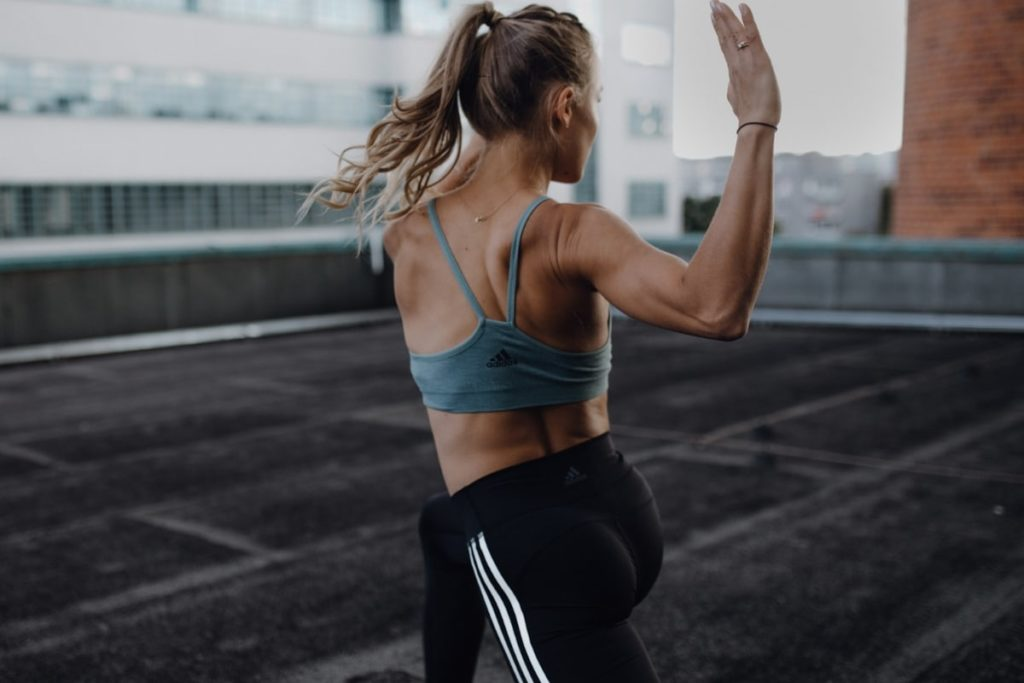 Woman exercising with focus on her back