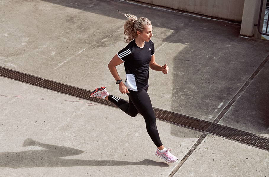 Woman is running on a street