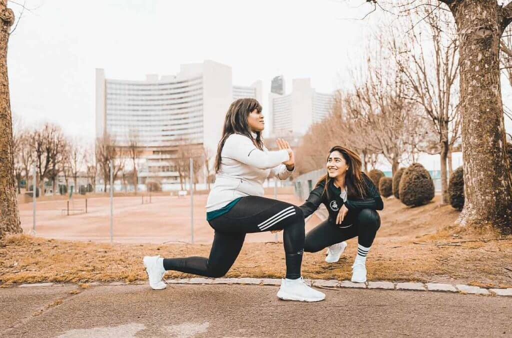 women doing workout while working on their fitness motivation