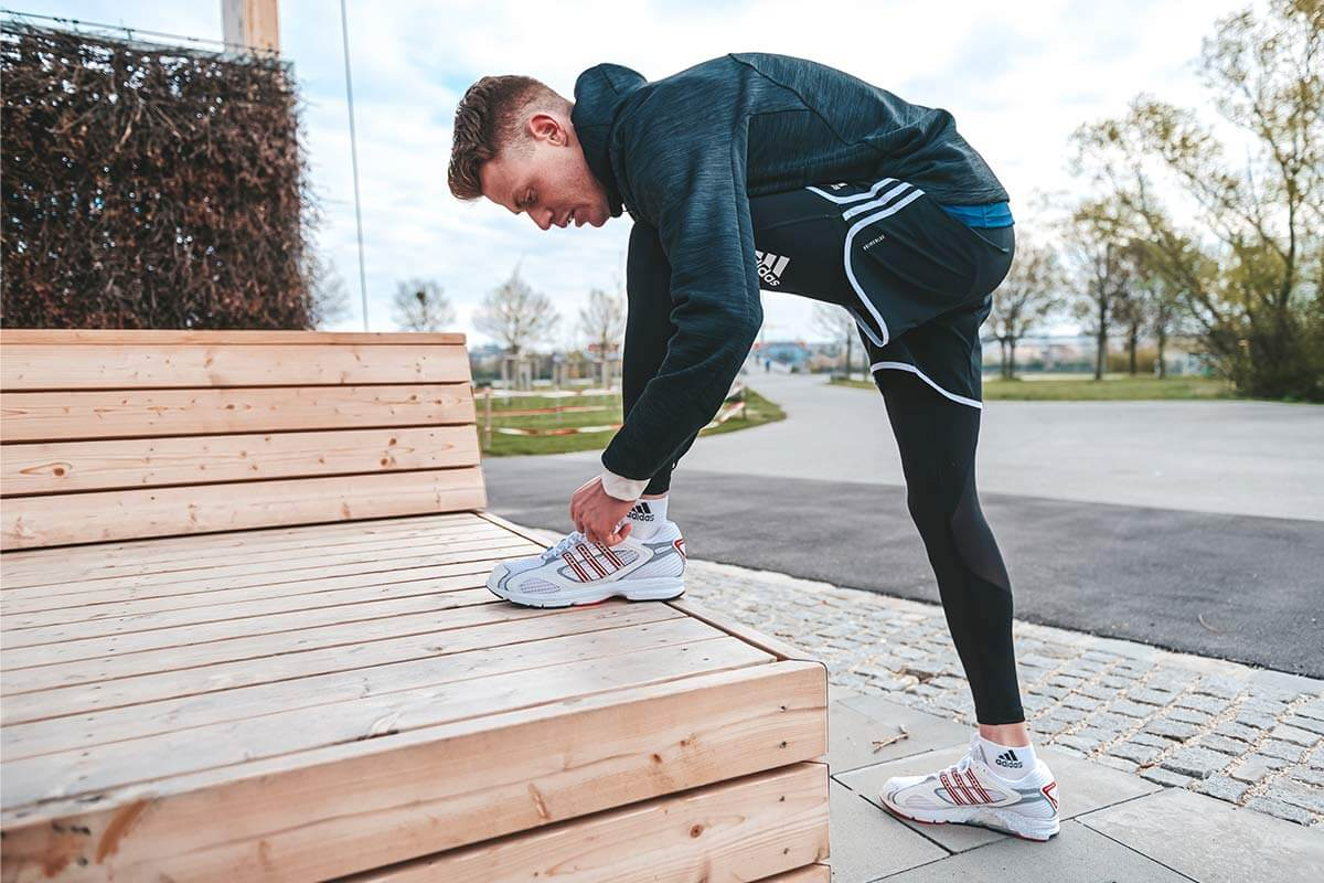Runner tying shoe laces