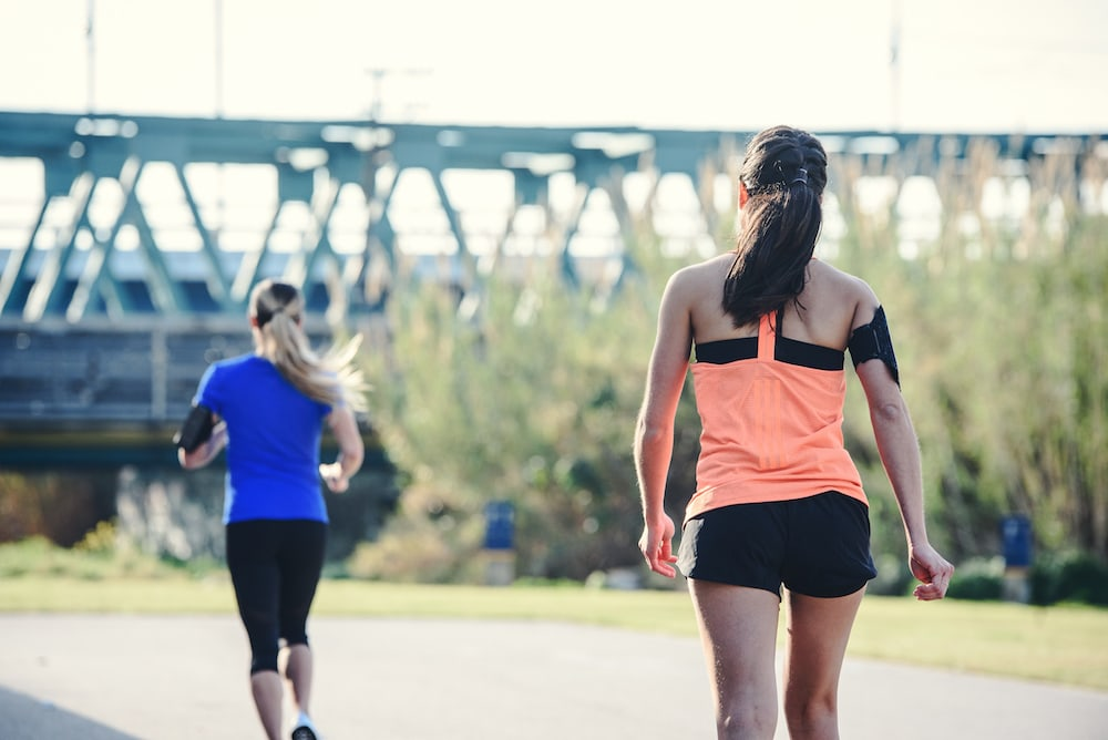 Two women walking and running outdoor