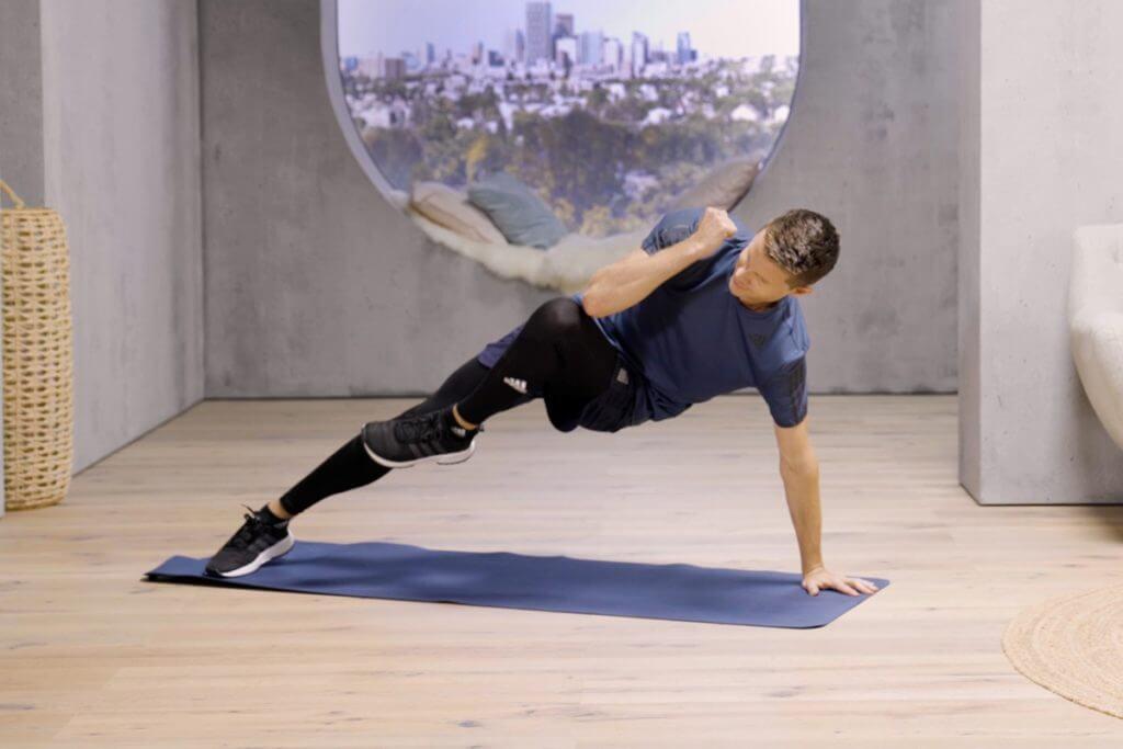 man doing plank variations