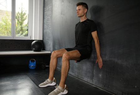 A man doing a wall sit