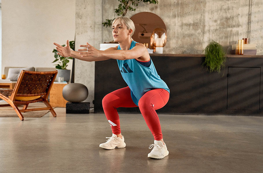 Woman in adidas clothes is starting her workout challenge at home