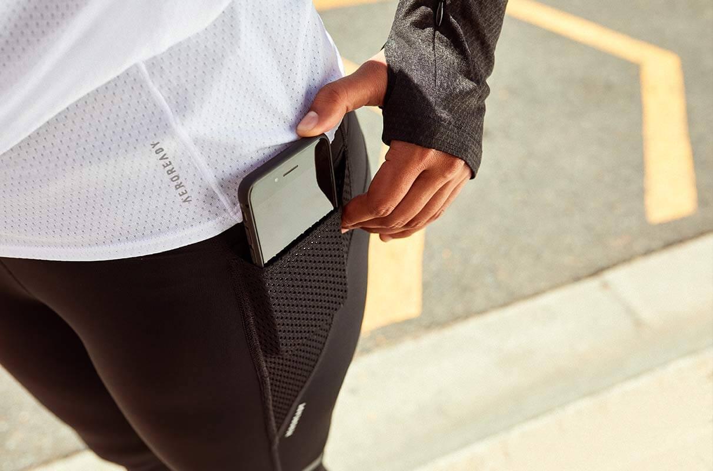 Man tracking run with phone