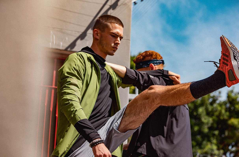 two men stretching