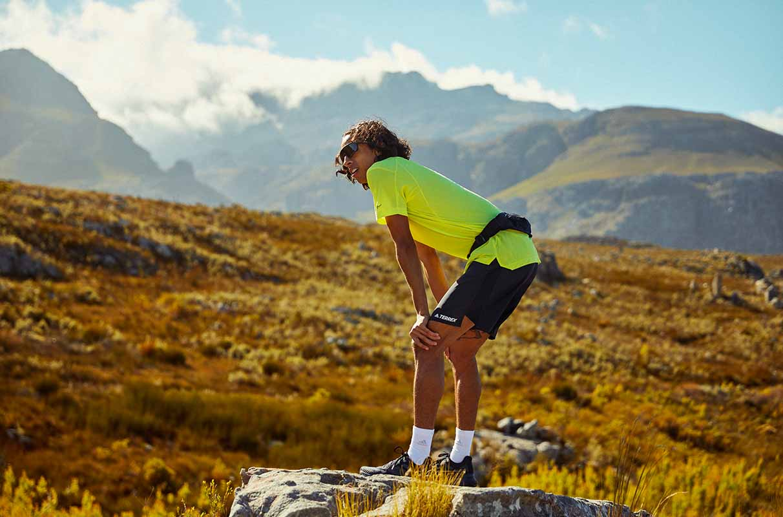 man resting on a trail run