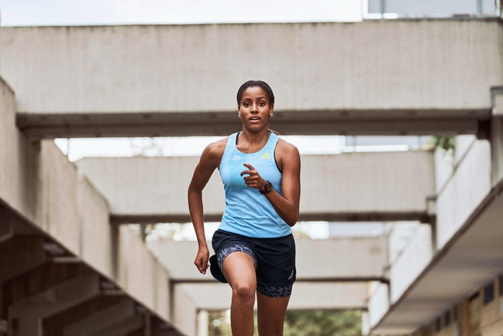 woman running in adidas gear