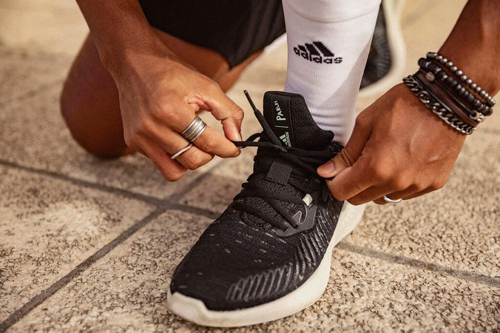 Tying adidas Parley running shoes