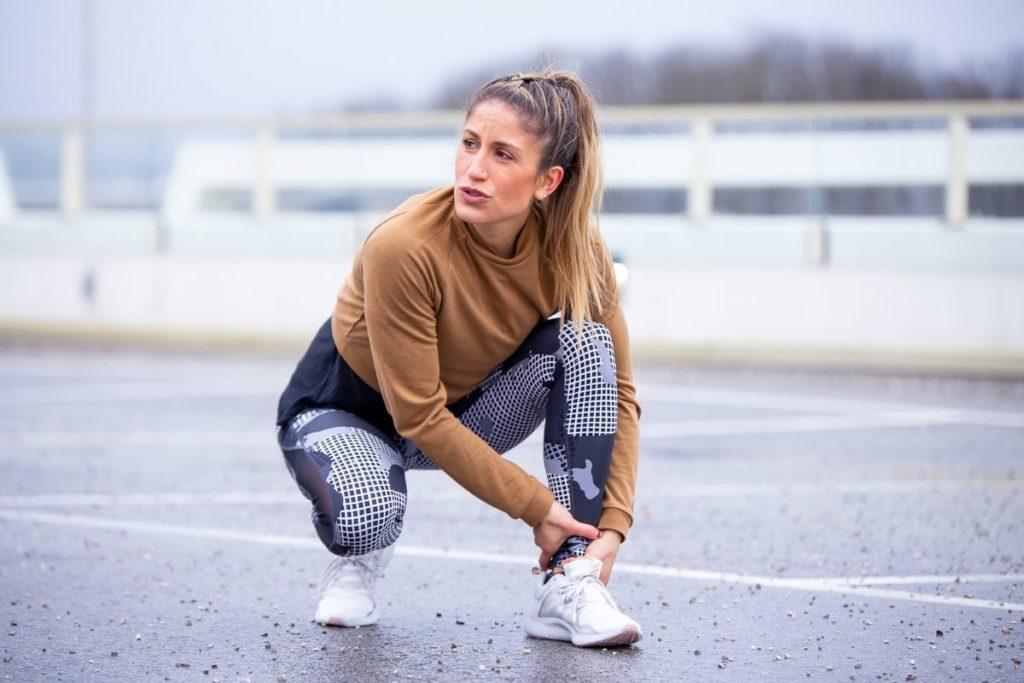 Woman tying shoelaces
