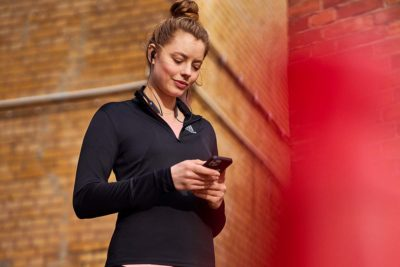 woman scheduling her workouts with adidas training